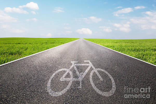 Straight Ahead Wall Art - Photograph - Bike Symbol On Long Straight Asphalt Road by Michal Bednarek