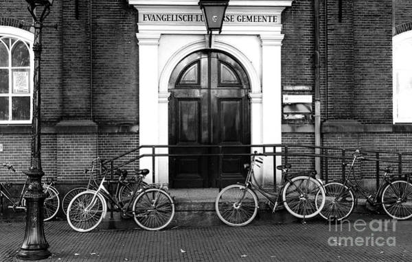 Photograph - Bike Wheels In Amsterdam Mono by John Rizzuto