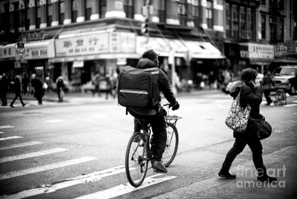 Photograph - Biking In The City by John Rizzuto