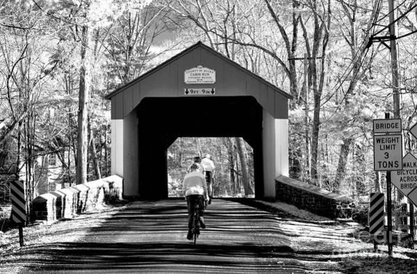 Photograph - Biking Under Cabin Run by John Rizzuto