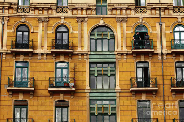 Photograph - Bilbao Balcony Conversation by James Brunker