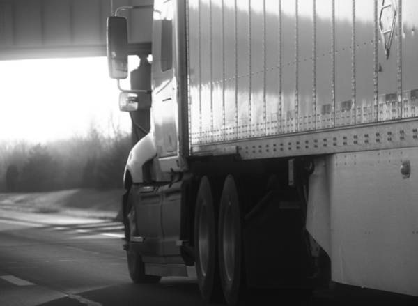 Wall Art - Photograph - Black And White Semi Truck On The Highway by Dan Sproul