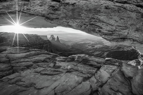 Photograph - Black And White Sunburst Mesa Arch Mountain Landscape by Gregory Ballos