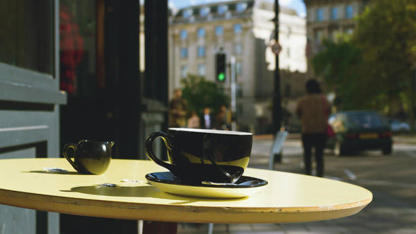 Photograph - Black Cup And Saucer With Milk Jug On A Street Cafe Table by Jacek Wojnarowski