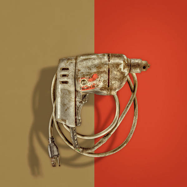 Wall Art - Photograph - Black Decker Drill Motor On Color Paper by YoPedro