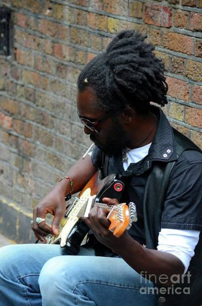 Photograph - Black Street Musician Sits Against Wall Plays Guitar London England by Imran Ahmed