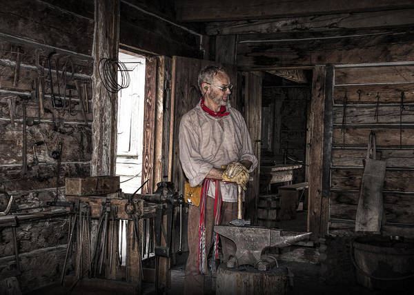 Photograph - Blacksmith At The Fort Edmonton Park In Alberta by Randall Nyhof