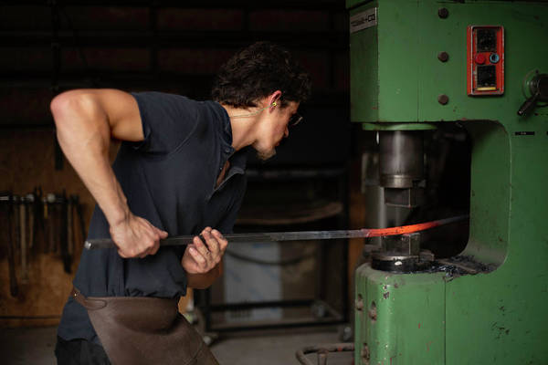 Photograph - Blacksmith At Work by Jean Gill