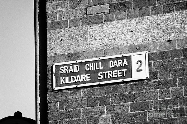 Gaelic Photograph - blue and white bilingual english irish street sign for kildare street in Dublin Republic of Ireland by Joe Fox