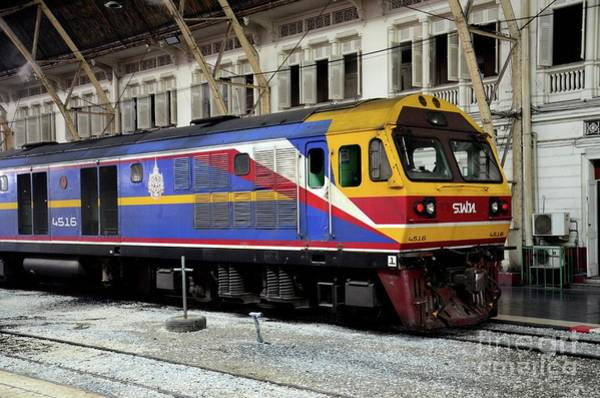 Photograph - Blue And Yellow Thai Railways Diesel Electric Locomotive Parked At Bangkok Train Station Thailand by Imran Ahmed