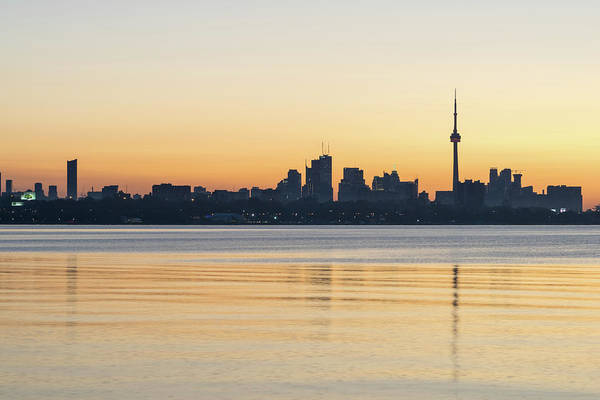 Photograph - Blue Breeze - Predawn Silhouette Of Toronto Skyline Over Water by Georgia Mizuleva