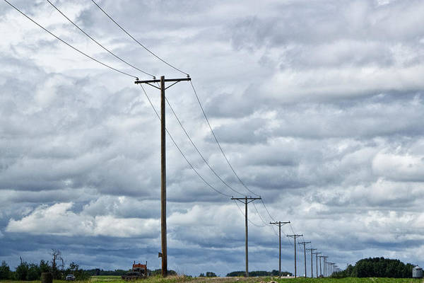 Photograph - Blue Clouds With Power Lines Over Farm Landscape In Saskatchewan Canada by Randall Nyhof