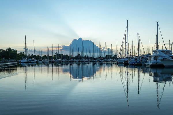 Photograph - Blue Sunrise Cloud - God Rays At Serene Marina by Georgia Mizuleva