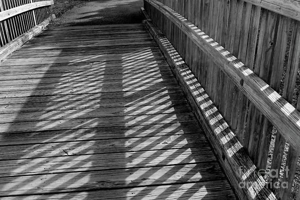 Photograph - Boardwalk Shadows Black And White by Karen Adams