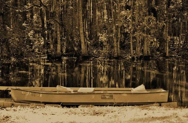 Photograph - Boat And Swamp Waters by Cynthia Guinn