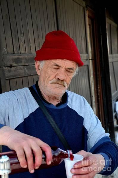 Photograph - Bosnian Vendor Pours Fresh Pomegranate Juice Sarajevo Bazaar Bosnia by Imran Ahmed