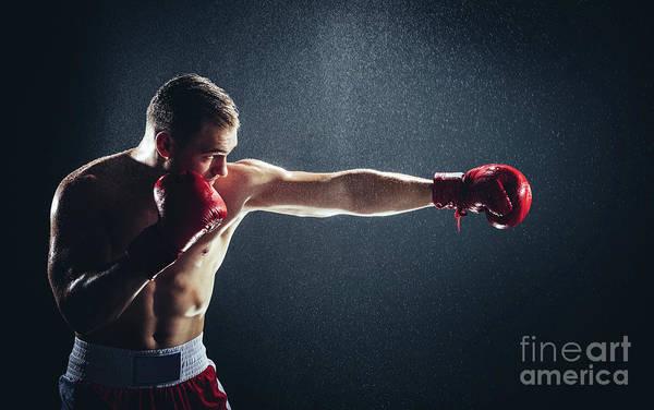 Kickboxing Photograph - Boxer Striking A Blow In The Rain. by Michal Bednarek