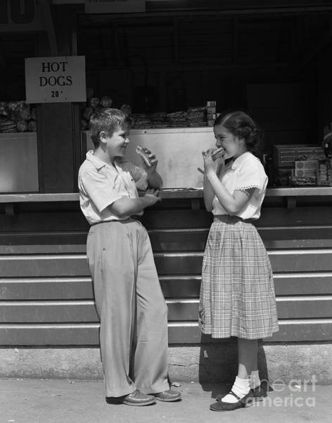 Photograph - Boy And Girl Eating Hot Dogs, C.1950s by H. Armstrong Roberts/ClassicStock