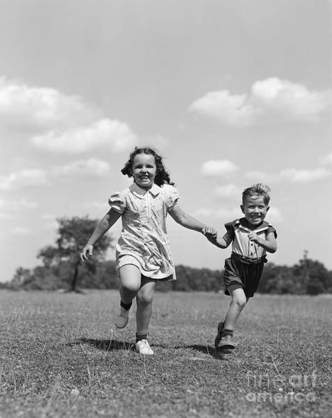 Photograph - Boy And Girl Running Through Field by H. Armstrong Roberts/ClassicStock