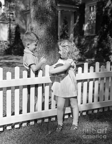 Photograph - Boy And Girl Talking Over Fence, C.1940s by H. Armstrong Roberts/ClassicStock