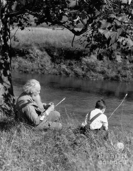 Angling Photograph - Boy And Grandfather Fishing by H. Armstrong Roberts/ClassicStock