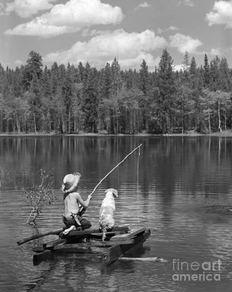 Angling Photograph - Boy Fishing On Homemade Raft by D. Corson/ClassicStock