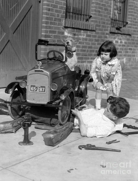 Service Dog Photograph - Boy Fixing Girls Toy Car, C.1920s by H. Armstrong Roberts/ClassicStock