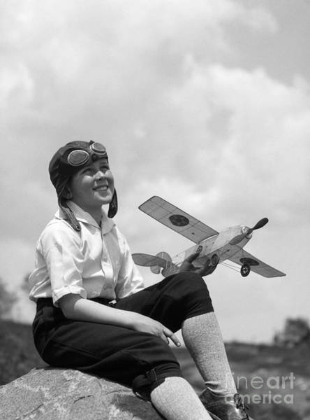 Photograph - Boy In Aviator Cap With Model Plane by H. Armstrong Roberts/ClassicStock