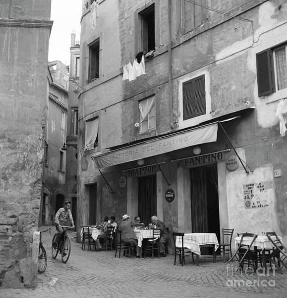 Wall Art - Photograph - Boy On A Bicycle On A Street In Rome, 1955 by The Harrington Collection