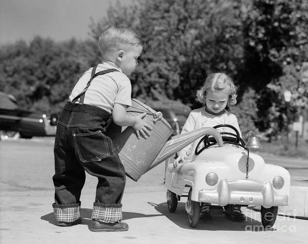 Pedal Car Wall Art - Photograph - Boy Playing Gas Station Attendant by H. Armstrong Roberts/ClassicStock