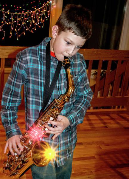 Boy Playing The Saxophone Art Print