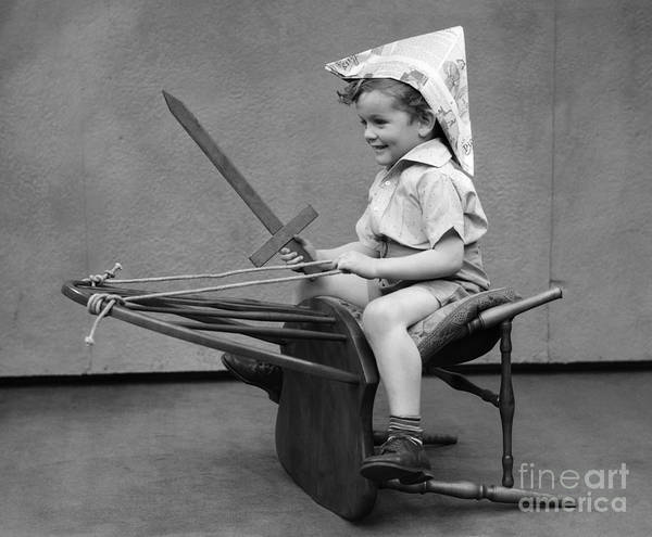 Steed Photograph - Boy Riding Chair As If It Were A Horse by H. Armstrong Roberts/ClassicStock