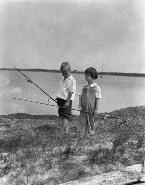 Photograph - Boys Walking Along Shore With Fishing by H Armstrong Roberts and ClassicStock