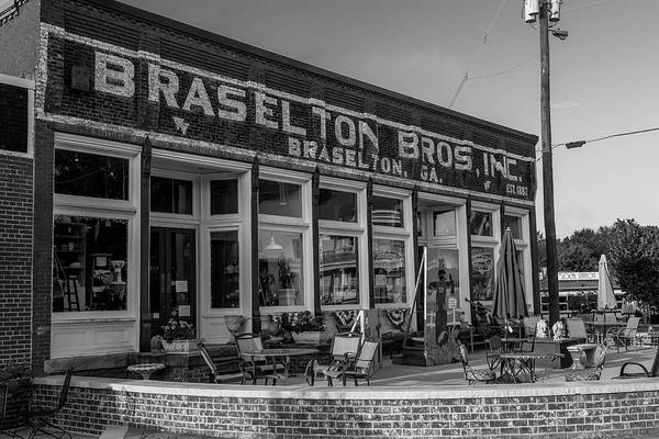 Photograph - Braselton Bros Inc. Store Front In Bw by Doug Camara
