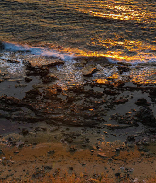 Sea Wall Art - Photograph - Breaking Waves On Rocky Seashore At Sunset by Iordanis Pallikaras