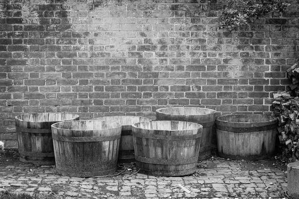 Wall Art - Photograph - Brick Wall And Barrels B W by Teresa Mucha