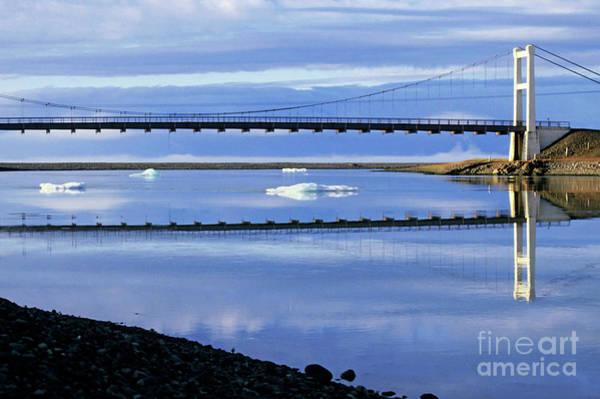 Wall Art - Photograph - Bridge Crossing Over Icebergs Floating In The Waters Of Jokulsarlon Lagoon by Sami Sarkis
