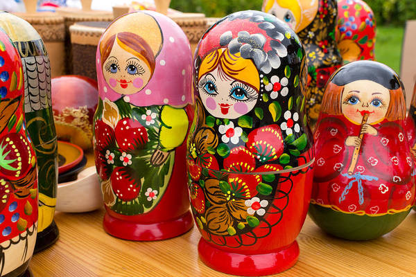 Photograph - Bright Russian Matrushka Puzzle Dolls by John Williams