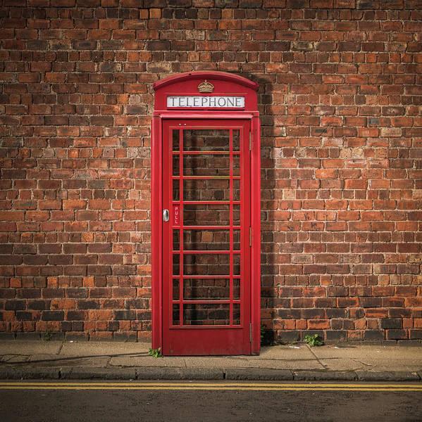 Wall Art - Photograph - British Phone Box Against Red Brick Wall by Mr Doomits