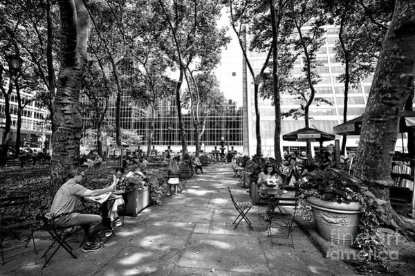 Wall Art - Photograph - Bryant Park Reading by John Rizzuto