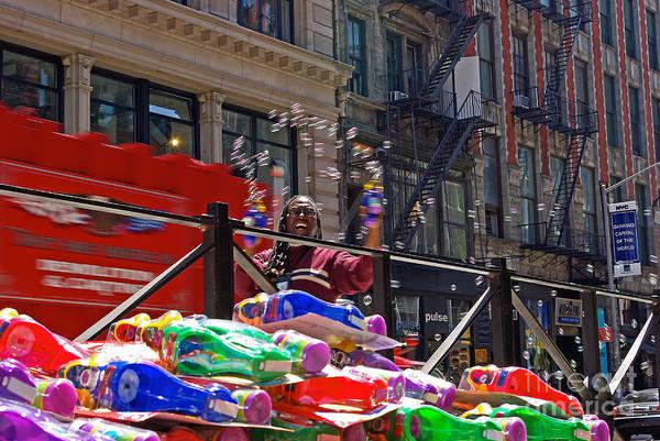 New York Wall Art - Photograph - Bubble Gun Seller In New York by Zal Latzkovich
