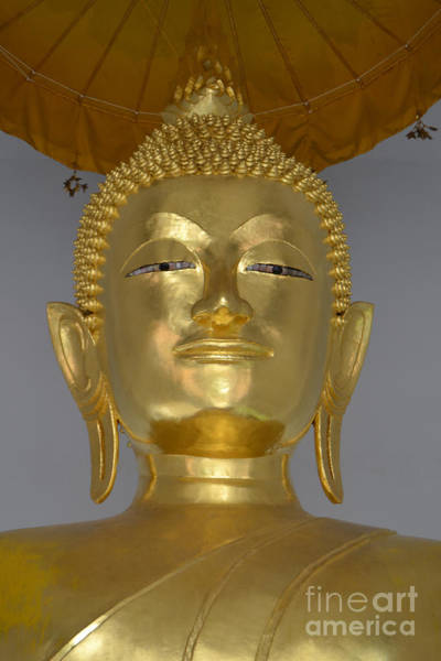 Rights-managed Wall Art - Photograph - Buddha Face Under An Umbrella At The Golden Mount by Heather Kirk