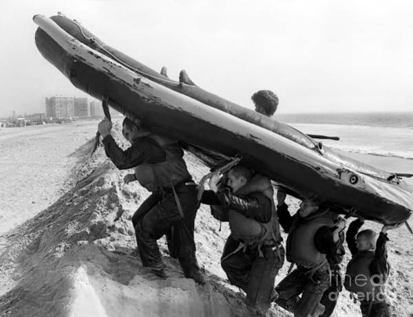 Navy Seal Photograph - Buds Students Carry An Inflatable Boat by Michael Wood