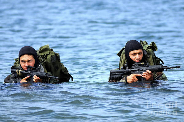 Special Operations Forces Photograph - Buds Students Wade Ashore During An by Stocktrek Images