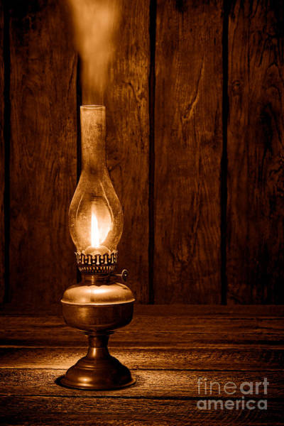 Oil Lamp Photograph - Burning The Midnight Oil - Sepia by Olivier Le Queinec