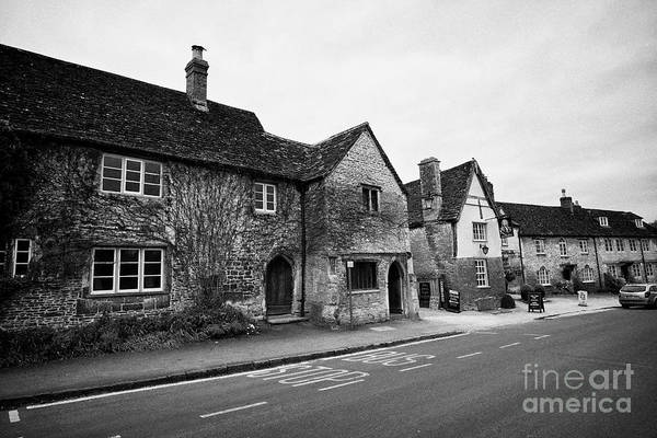 Wall Art - Photograph - bus stop and the george inn in the village west street Lacock village wiltshire england uk by Joe Fox
