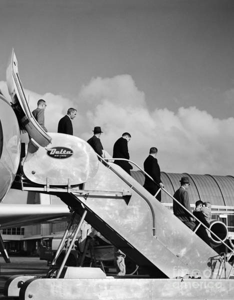 Photograph - Businessmen Exiting A Plane by H. Armstrong Roberts/ClassicStock