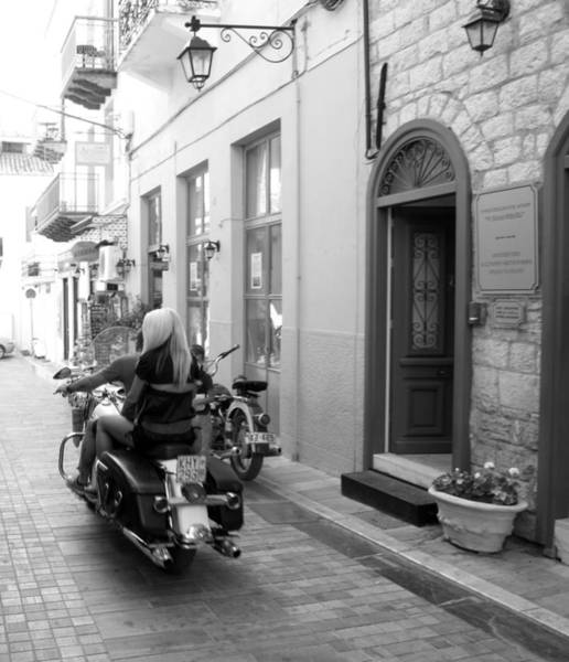 Photograph - Bw Girl Riding On Motorcycle With Handsome Bike Rider Speed Stone Paved Street Nafplion Greece by John Shiron