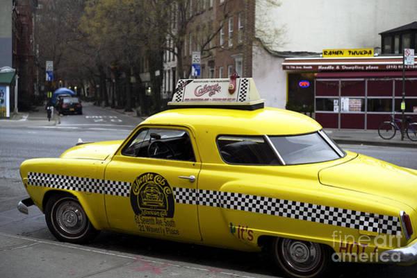 Wall Art - Photograph - Caliente Yellow Cab by John Rizzuto