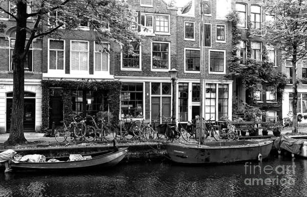 Photograph - Canal Boats In Amsterdam Mono by John Rizzuto